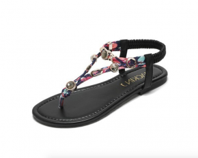 Strappy sandals with elastic heel strap and gold charm detailing