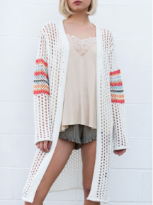 Lightweight open weave cardigan features a colorful fun stripe detail on sleeve and back yoke