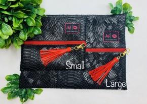 black cobra makeup junkie bag with tassels