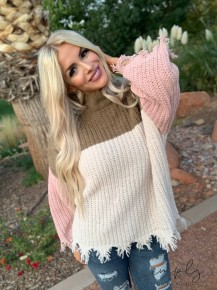 POL- Long sleeve turtle neck color block sweater with distressed detail (100% polyester)