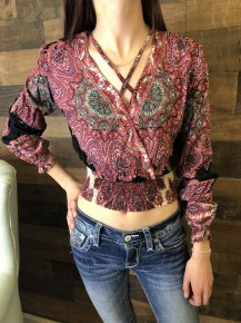 Black long sleeve criss cross neck top with paisley pattern
