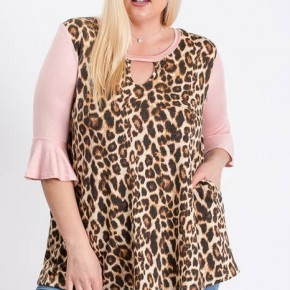 Plus size  print top with solid flounce