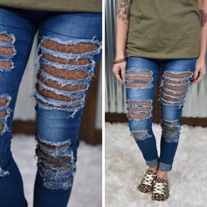 L & B Leopard Distressed Skinny Jeans