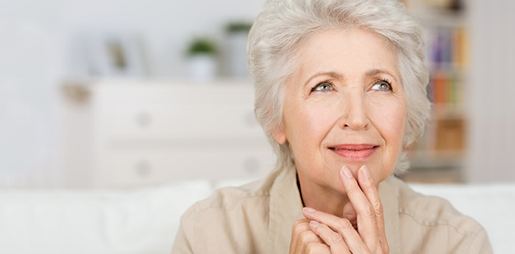 elderly woman thinking and smiling