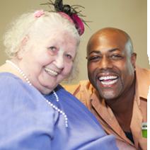 A nurse and patient smiling.