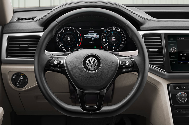 Black leather Volkswagen steering wheel and dashboard