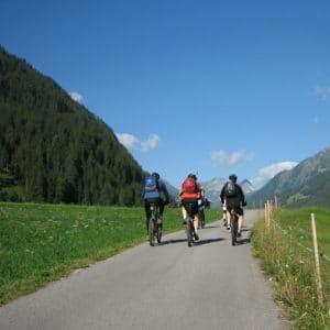 man cycling back pain