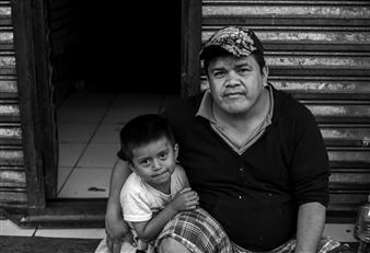 Ada Luisa Trillo - The Migrant Caravan - Tony and his son Alex Photograph on Fine Art Paper, Photography