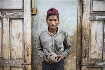 Safaa Kagan - Boy Holding Ball Archival Pigment Print, Photography