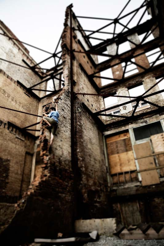 Mark Osbourne climbing on a decaying building on Main St.