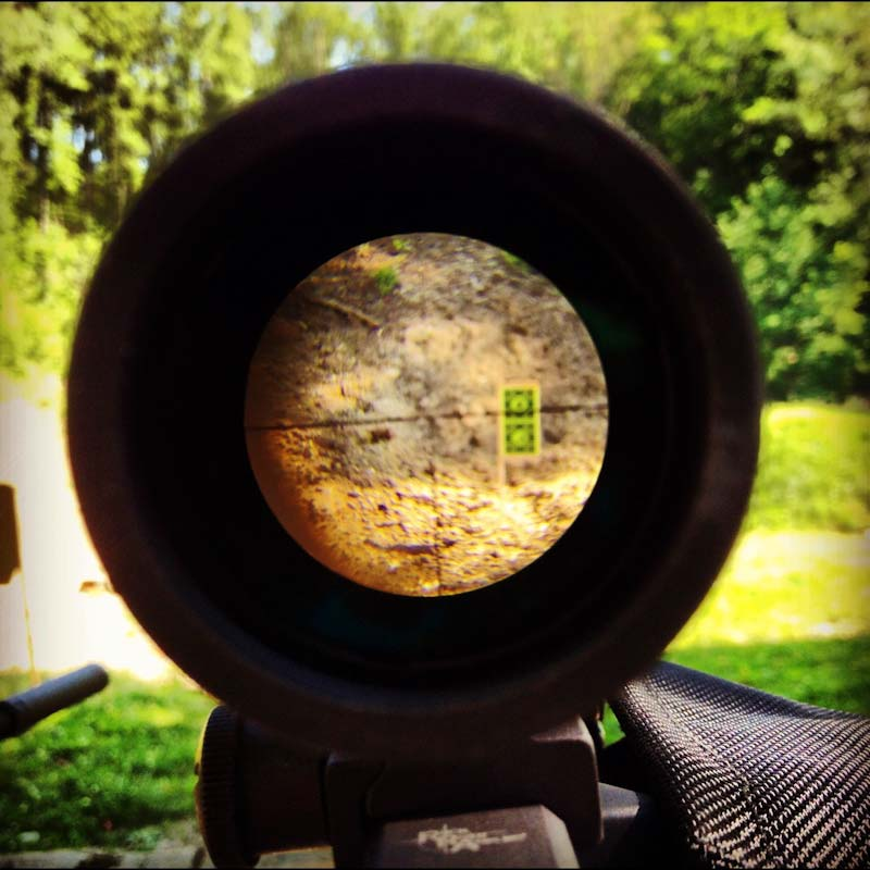 A scope on a sniper rifle.