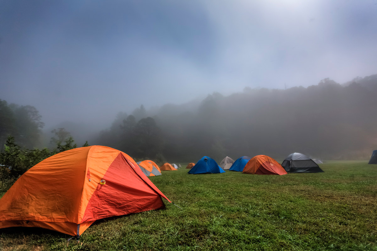 Climbers sleep in their tents during a foggy night at Miguel's Pizza.