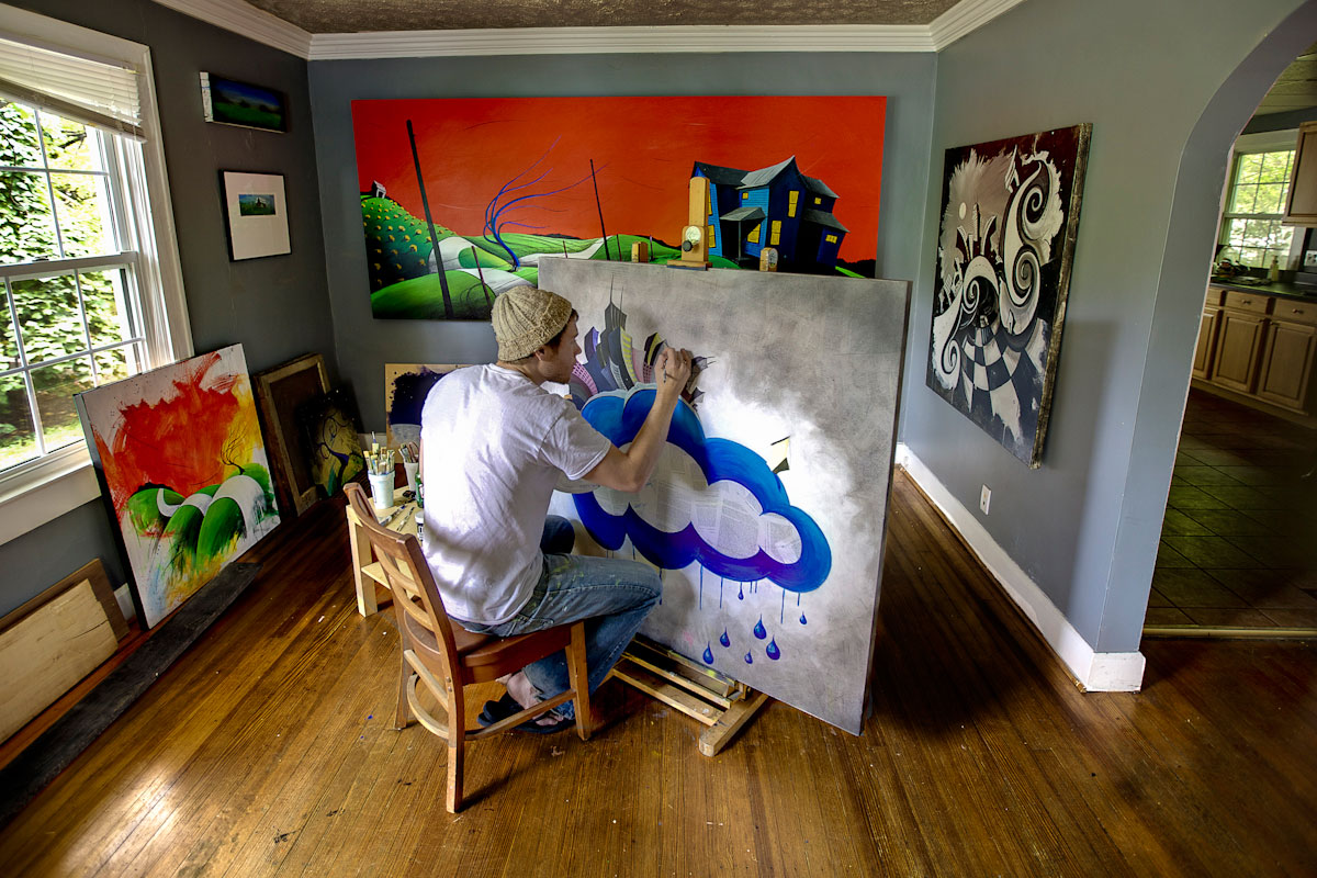 Artist Justin Vining paints in his studio.
