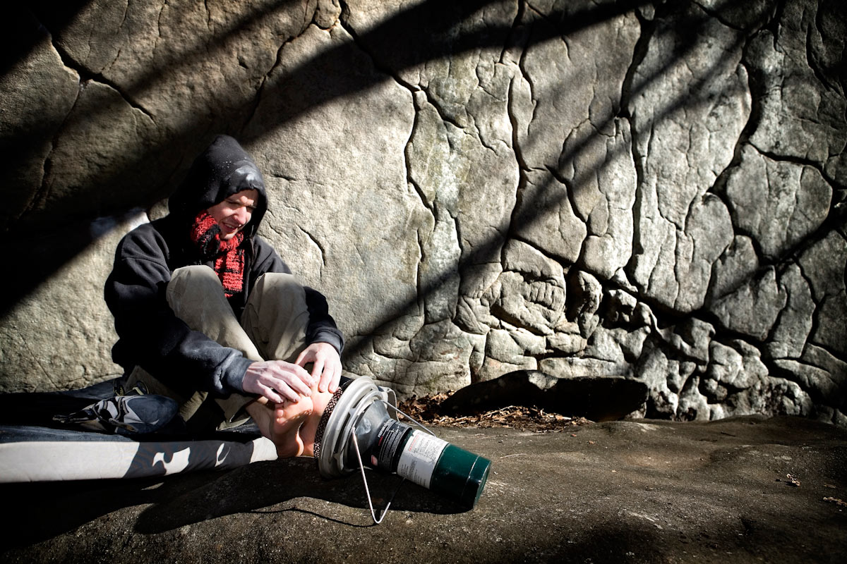 Pro-climber, Jason Kehl warms up the digits in 25 degree weather before hoping back on the rock.