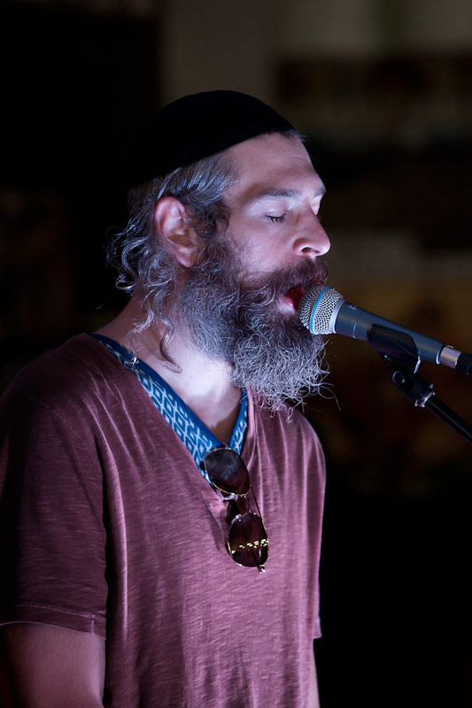 Matisyahu (Matthew Paul Miller) sings at an in store concert.