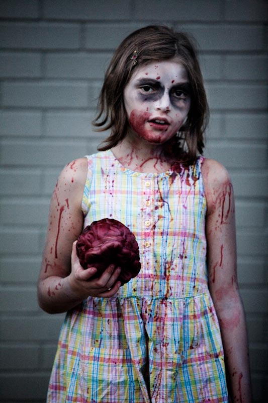 A young girl dressed as a zombie for the Zombiewalk.