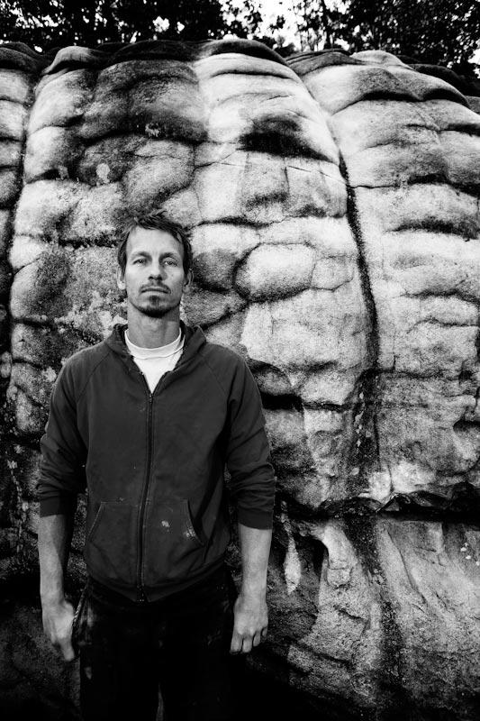 Developer Adam Henry in front of the Millipede boulder