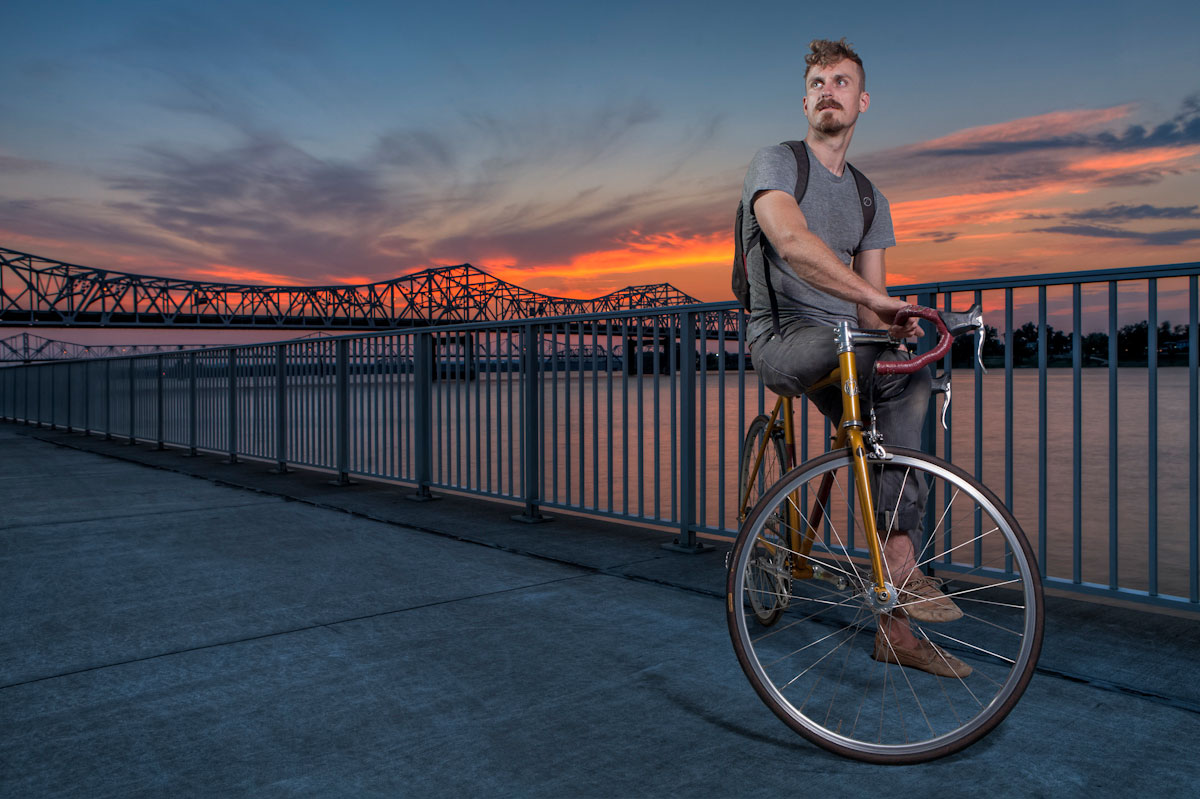Carl Bakanowski sits on his bicycle during sunset.