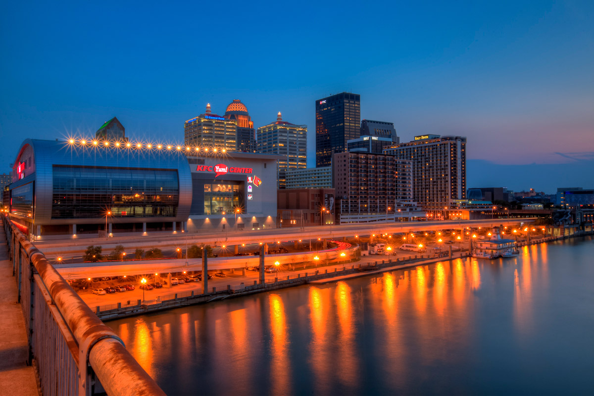 Downtown Louisville starts to light up as the sun sets and twilight begins.