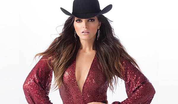 ana barbara with hands on hips and cowboy hat