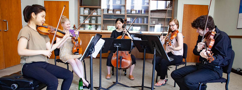 Students practicing in the Library