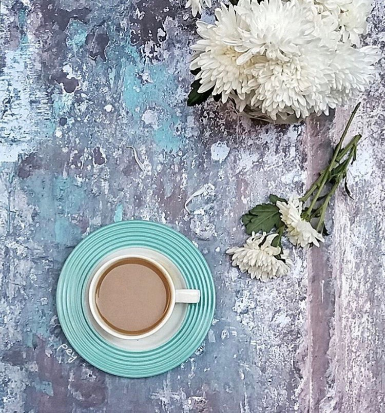 Slowing down to speed up - a cup of tea and some flowers on a table