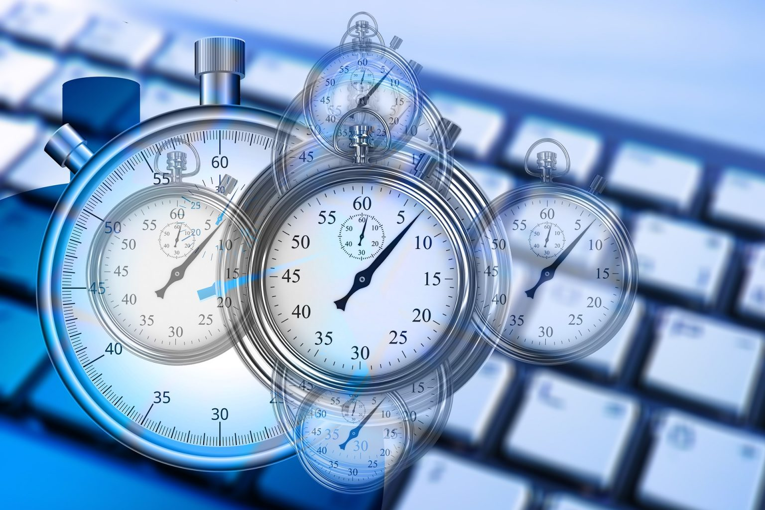 clocks and stopwatches above a workspace