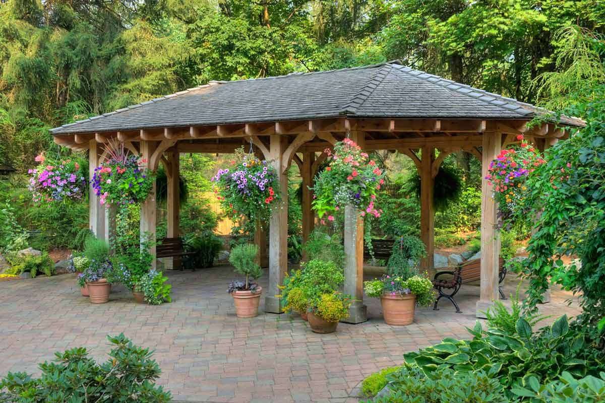 7 backyard gazebo ideas for sun shade and rain shelter for Small garden shelter