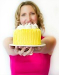 White background  pink shirt  yellow cake cropped