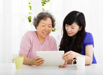 Mother daughter on tablet   asian medium small