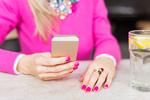 Bigstock-woman-using-mobile-phone-in-ca-84410081