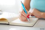 Woman_hand_writing_blue_pen