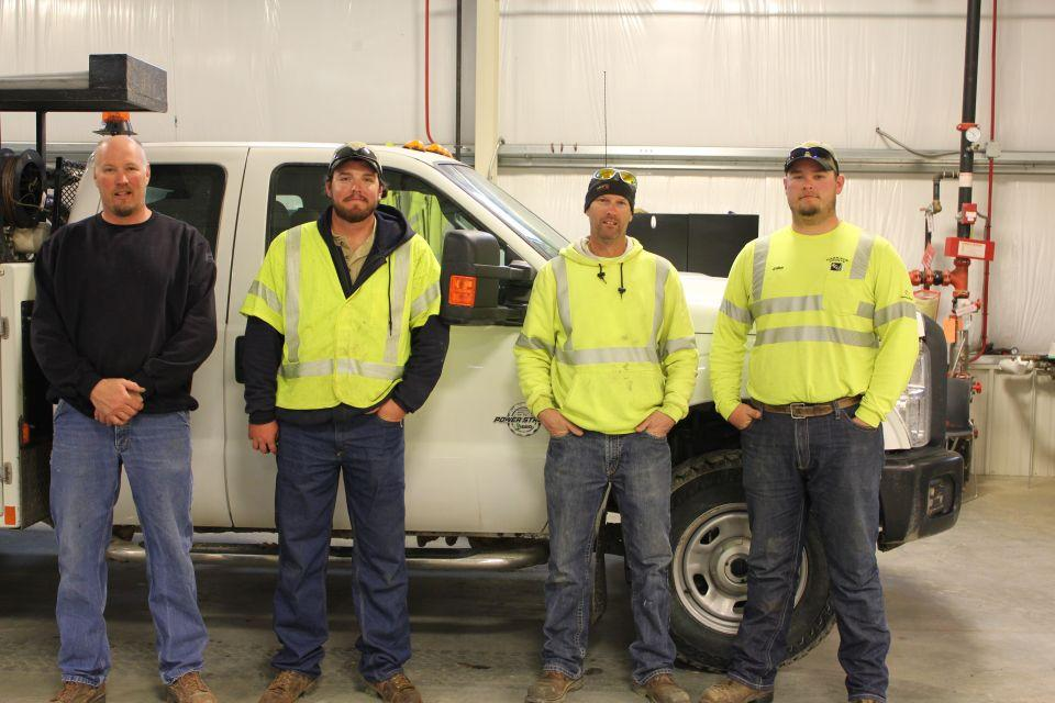 Line workers who traveled to assist in Minnesota