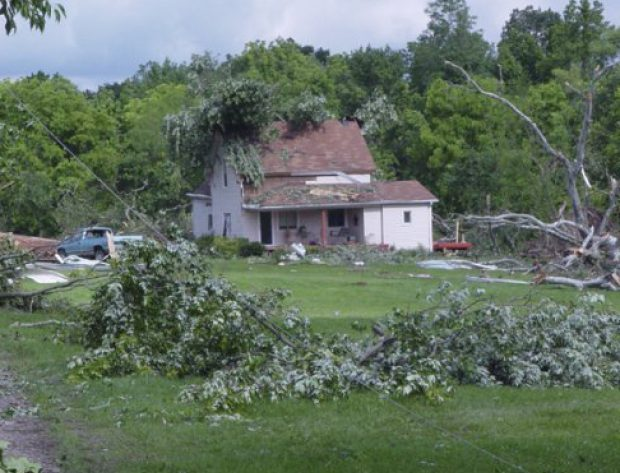 Home after a storm with downed trees and power lines