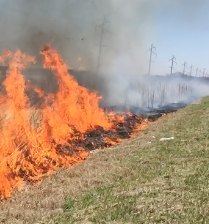 ditch on fire with smoke