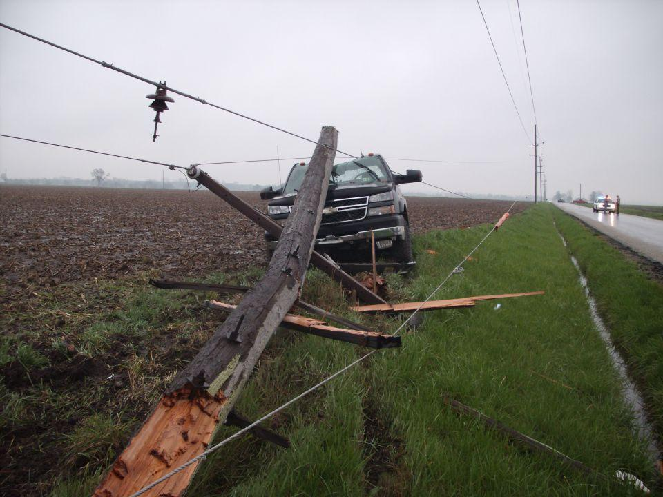 Power pole and lines on top of vehicle