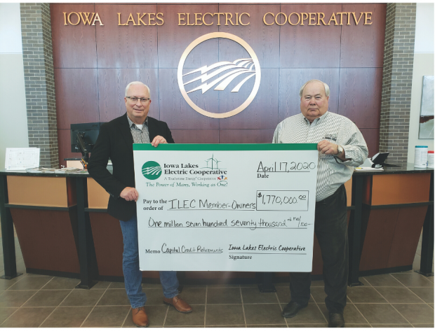 Rick Olesen and Jerry Beck hold up big check made out to ILEC member-owners for $1.77 million in capital credit retirements.