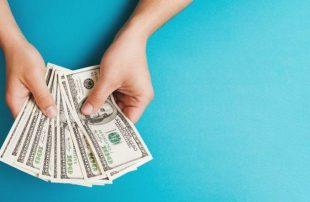 Hands holding dollar bills