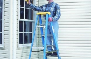 man on ladder caulking