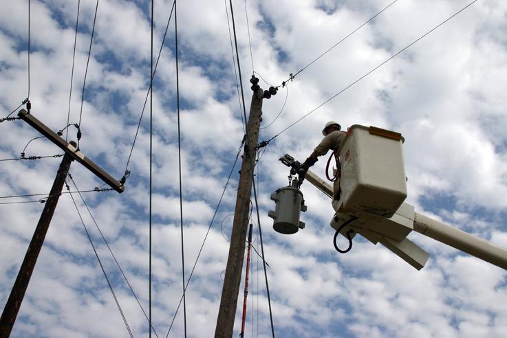 Lineworker on a pole in a bucket