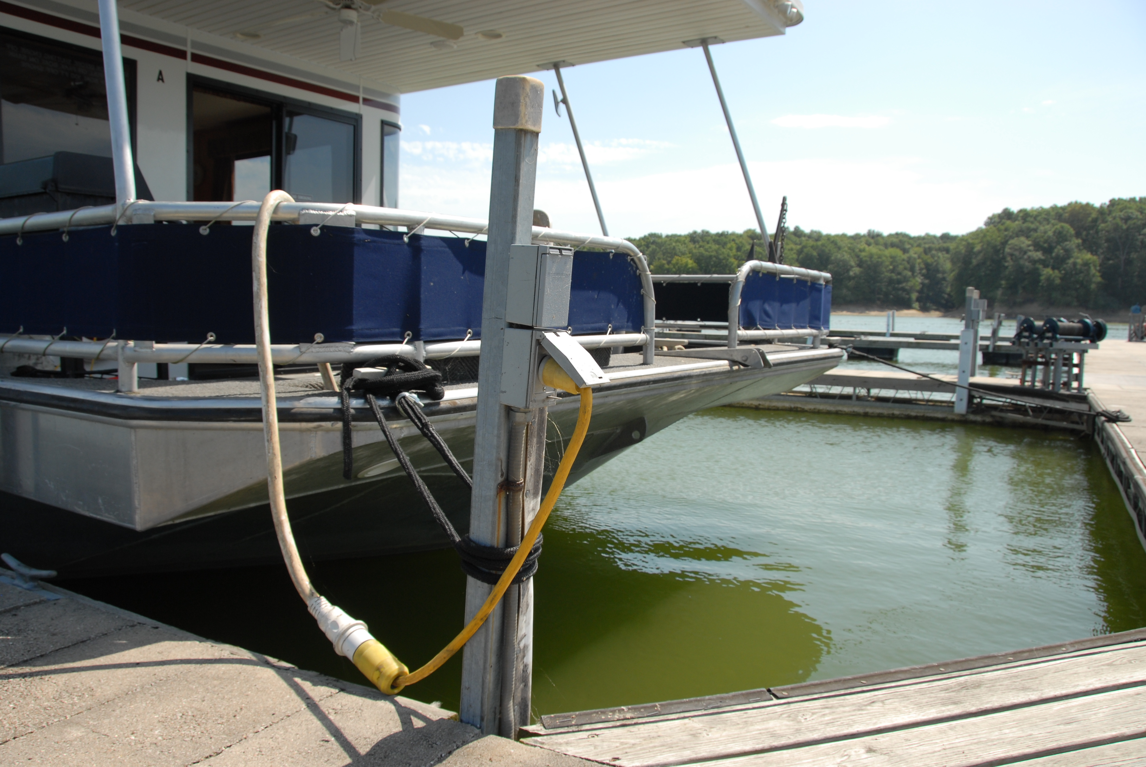 boat docked near electrical outlet