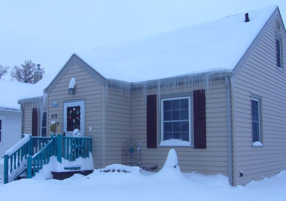 image of a house with icicles hanging from the roof
