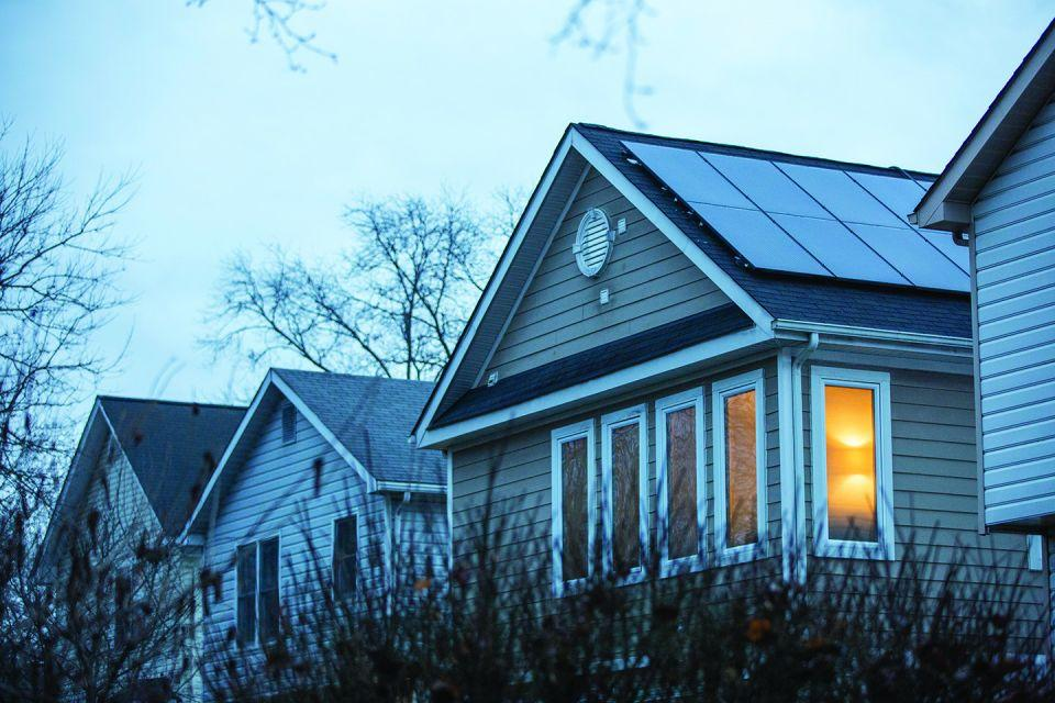 Photo image of solar panels on the roof of a house.
