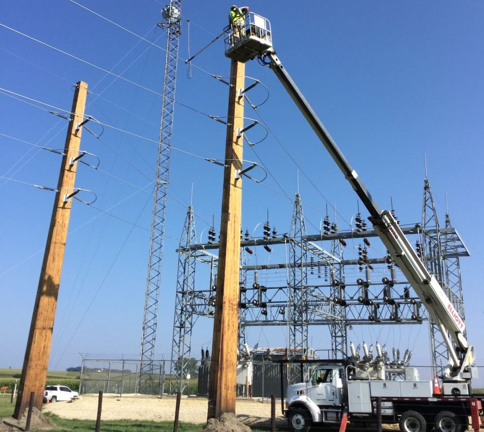 A NIPCO line worker doing work on a shoo-fly high above L2 Substation