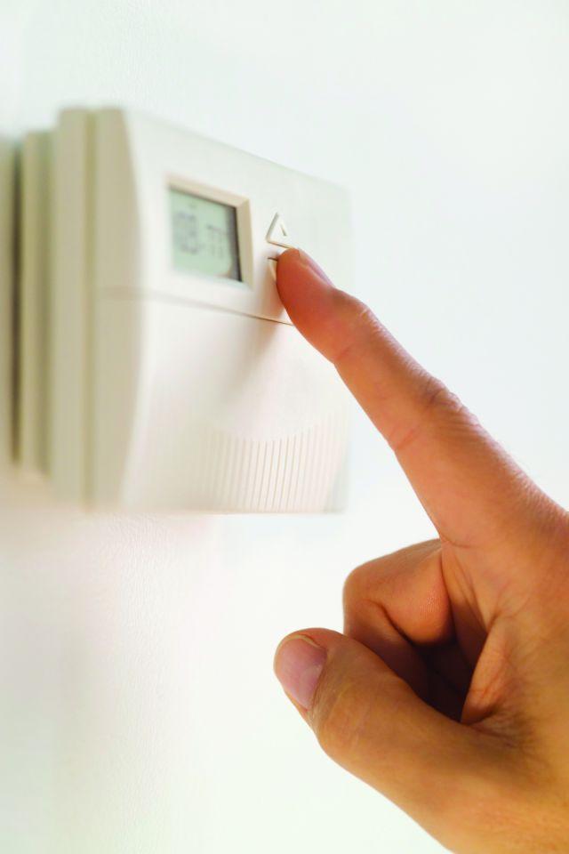 adjusting a thermostat