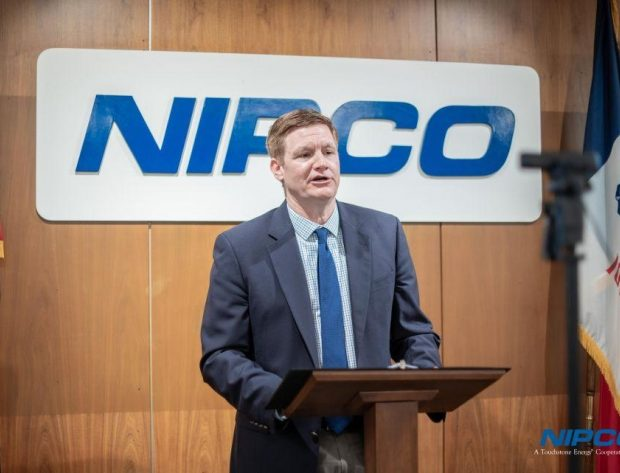 NIPCO's General Manager Matt Washburn presents from a podium at the NIPCO annual meeting