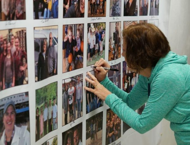 A NIPCO employee signs the pledge banner near her family photo to symbolize her commitment to work safely.