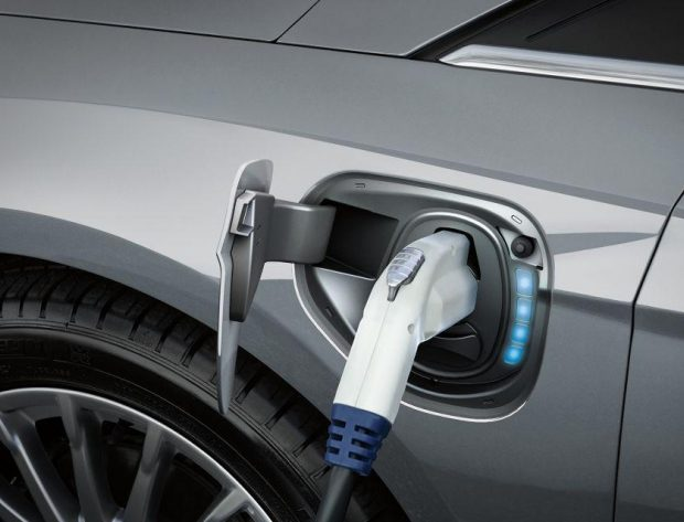 Photo image of an electric vehicle charger plugged into an electric vehicle. Electric vehicles, like the Ford Focus BEV shown here, reduce exhaust emissions. Photo Credit: Ford Motor Company.