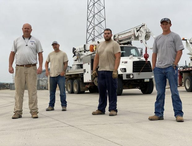 Photo of the four NIPCO line crew who assisted in the restoration efforts