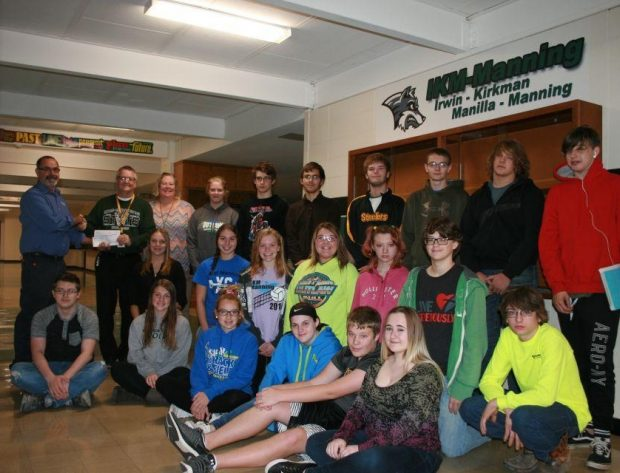 Students and teachers from IKM-Manning school are pictured with Nishnabotna Valley REC's Rich Freml.